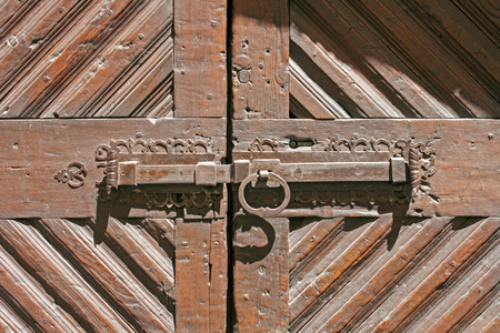 latch: Old latch on a door in Bormio Stock Photo