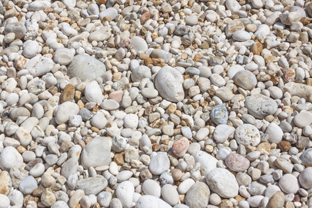background with white and coloured pebbles Stock Photo