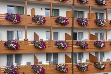 Geometries of colored flowers and wood on flowered balconies 版權商用圖片