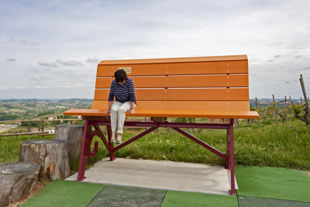 One of the colorful Giant Benches, placed between the vineyards and the countryside of the Langhe, Italy