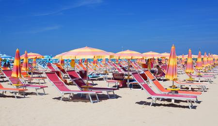 loungers: Sun loungers at beach Adriatic sea. Rimini