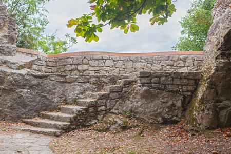 steps and staircases: Old stone staircase to the top of the mountain on the sky background.