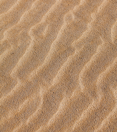 fanciful: Fanciful patterns on the sand created by the wind-background texture.