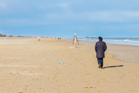 adult footprint: Male from strolling in solitude along the beach in cool autumn day.