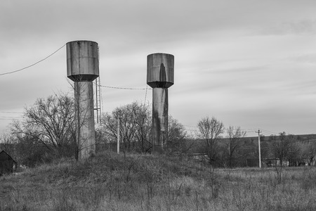 vacant lot: Round rusty metallic high towers on the  vacant lot.