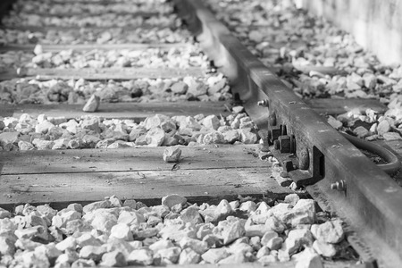 railway points: Old rusty bolts fastening the rails to the sleepers, close-up. Stock Photo