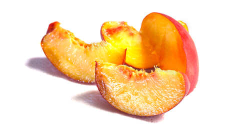 Ripe sliced peach on a white background close-up. Stock Photo