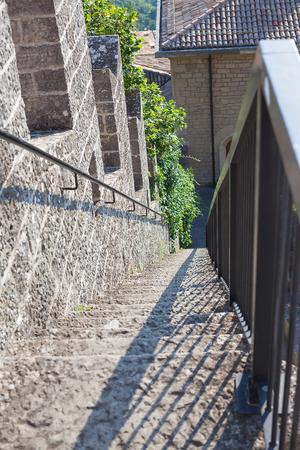 railing: Steep stairs with metal railing