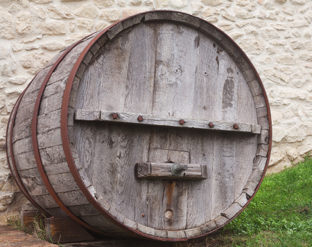 big cork: Large wooden barrel standing in the street. Stock Photo