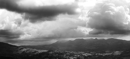 Storm clouds above a mountain village.Mountain landscape
