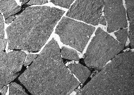 Paving slabs.Granite paving slabs.Stone road.