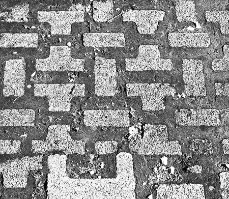 Paving slabs and grass.Pavement.Sidewalk. Backgrounds. Stock Photo