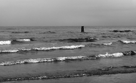 The troubled sea in the autumn cloudy day.