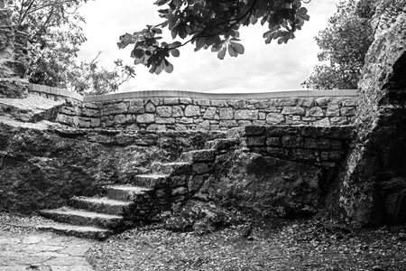 Old stone staircase to the top of the mountain on the sky background.