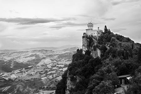 Fortress on top of the mountain against the sky and the city at the bottom. Editorial