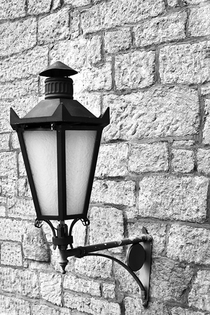 Street lamp on the wall of the tower. Lantern on a wall.