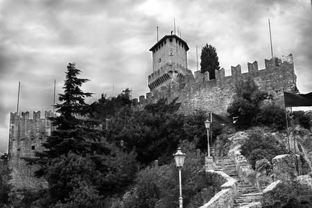 Rocca della Guaita.Castle in Italy.Stone wall of the castle on the mountain top.