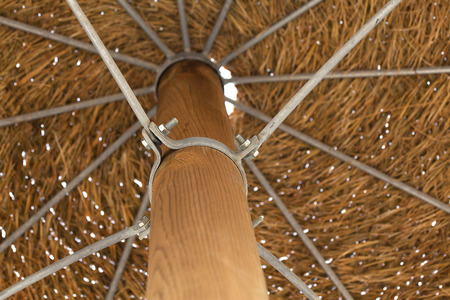 Thatched roof of beach umbrella close-up.