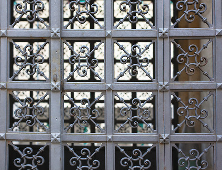 Detail of a beautiful iron fence carved close-up.