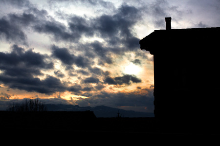 Silhouette of a house against a beautiful sunset. Stock Photo
