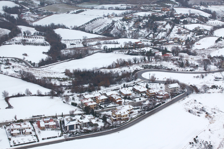 The village and fields in the snow. Beautiful view.