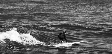 One surfer in the water waiting for the wave.