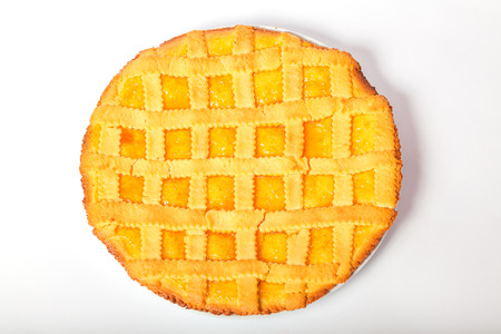 Crostata with apricot jam.  Isolated white background. Reklamní fotografie
