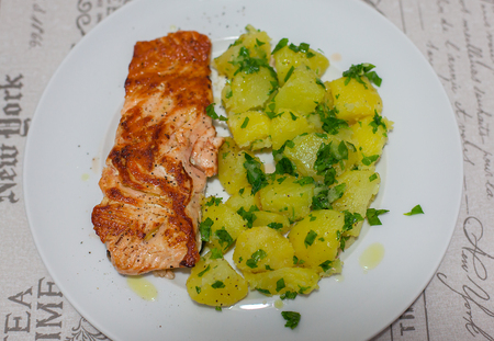 Salmon with boiled potatoes and parsley. Reklamní fotografie