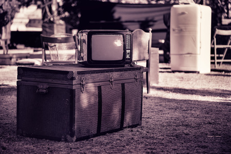 Old TV, chest and various furniture on the street.