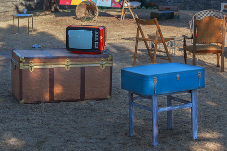 Old TV, chest, suitcase and various furniture on the street. Reklamní fotografie