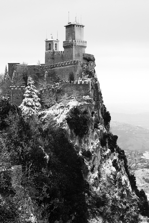 The fortress on top of a cliff on a cloudless winter day.