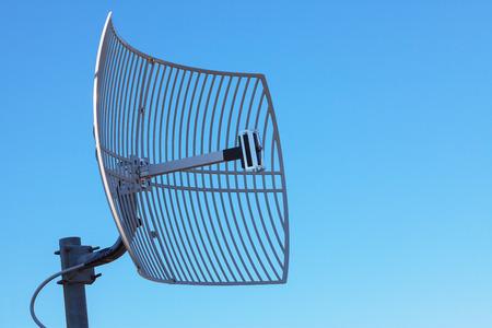 Antenna TV on blue sky background. Technological network.
