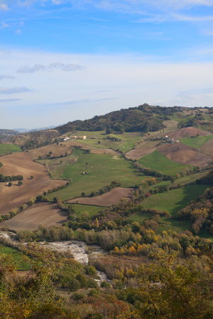 Fields and rarely come across houses on hilly terrain in autumn.