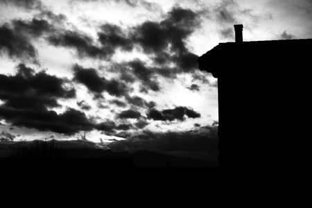 Silhouette of a house against a beautiful sunset. Reklamní fotografie