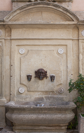 Antique street drinking fountain close-up.