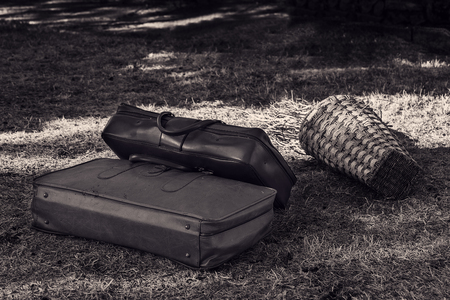 Two old suitcases on the grass close-up.