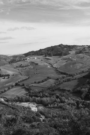 Fields and rarely across houses on hilly terrain in autumn. Reklamní fotografie
