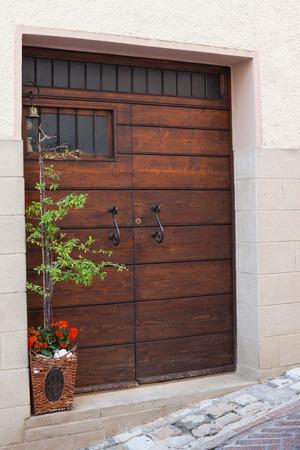 Old wooden door with beautiful metal handles close-up.