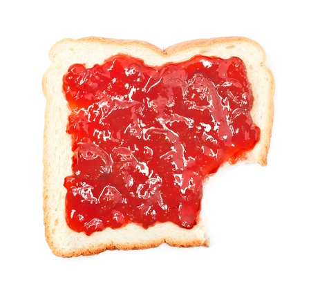 bite: bite out of a slice of bread with strawberry jam on white background Stock Photo
