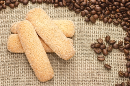 Traditional Italian sugar biscuit cookies with coffee beans on sacking background photo