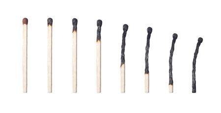 burned matches on white background photo