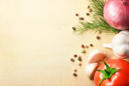 cutting vegetables: Photo of vegetables fresh tomato with onion, garlic and spices on cutting board Stock Photo