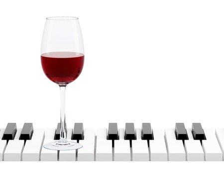 wine glass on piano key on white background