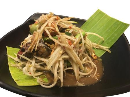 Som Tum or Papaya salad on banana leaf, traditional food of thailand. Isolated background