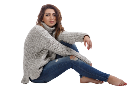 Girl posing in jeans and sweater
