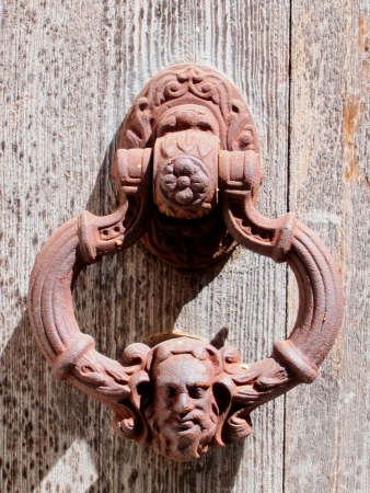 Iron rusty door knocker photo