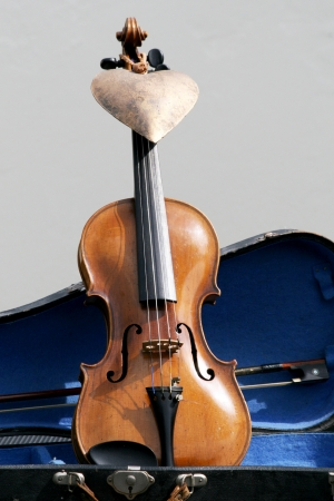 Violin in violin case with bronze heart photo