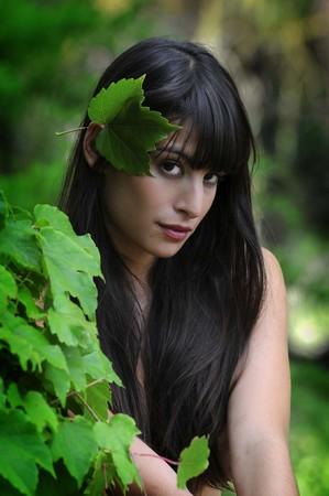 Gorgeous and sensual young brunette woman in the garden