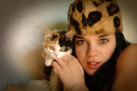 Sensual young naked girl with a cat