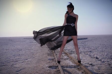 Gorgeous young girl on the salt flat
